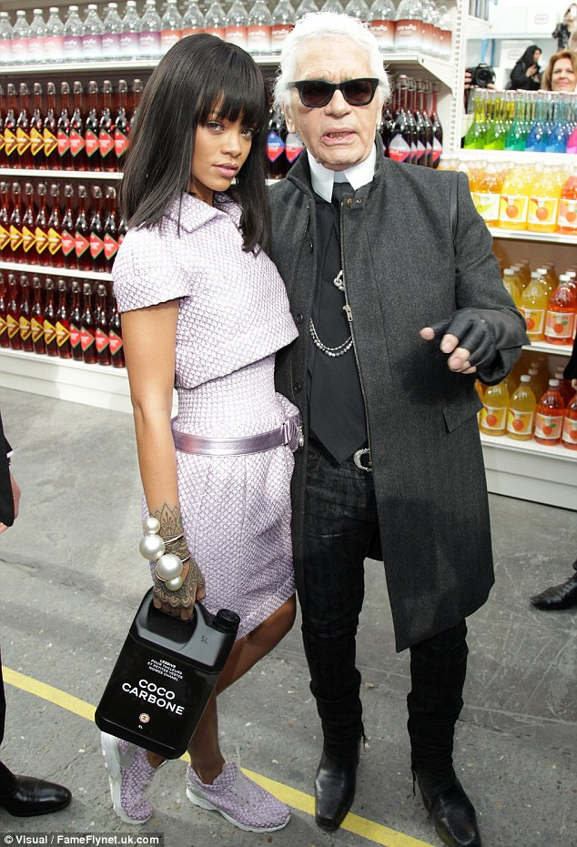 Anything you please: Rihanna seemed to have fun perusing the 'supermarket' with Karl