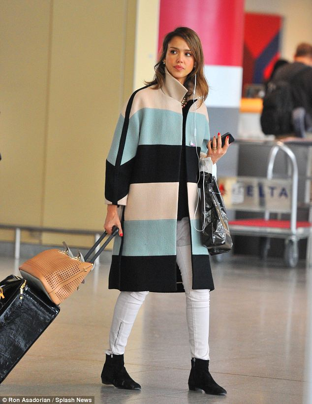 Coordinated: The actress teamed her striped coat with white jeans and black boots