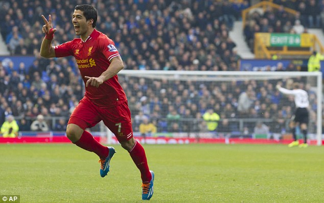 Just two good: Suarez wheels away to celebrate the second of his double against Everton last November