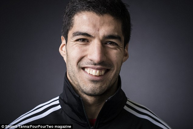 All smiles: Luis Suarez says him on and off the pitch are two different characters
