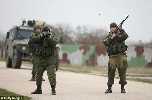 Flashpoint: Moments earlier, Russian troops fired warning shots into the air as around 300 Ukrainian soldiers marched toward the airfield to demand their jobs back
