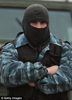 A line of pro-Russian militants guard the Russian occupied Belbek airbase