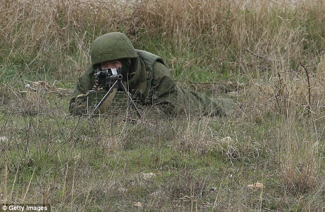 Marksmen: A Russian soldier guards the occupied Belbek airbase after Ukrainian troops marched on the area
