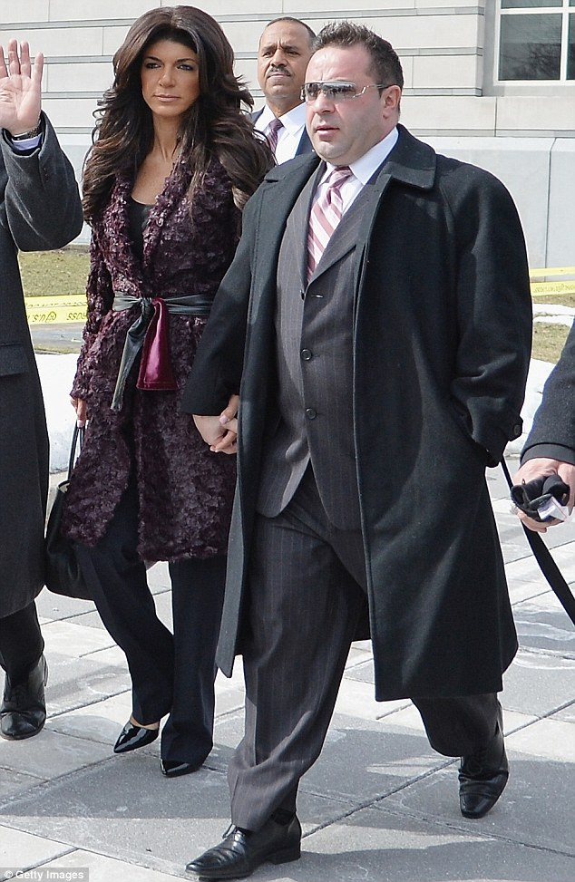 Leaving court: Teresa Giudice and Joe Giudice leave court after pleading guilty to fraud charges in court on Tuesday in Newark, New Jersey