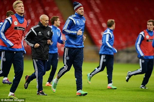 Preparation: Arsenal striker Nicklas Bendtner trains at Wembey with his Denmark team-mates
