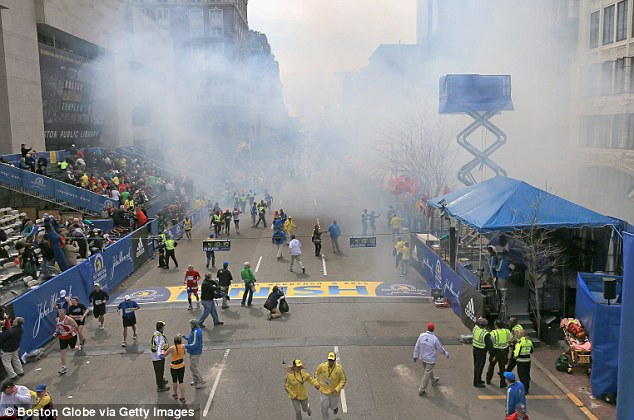 Tragic day: Two explosions went off near the finish line of the 117th Boston Marathon on April 15, 2013 killing three and injuring more than 260 people