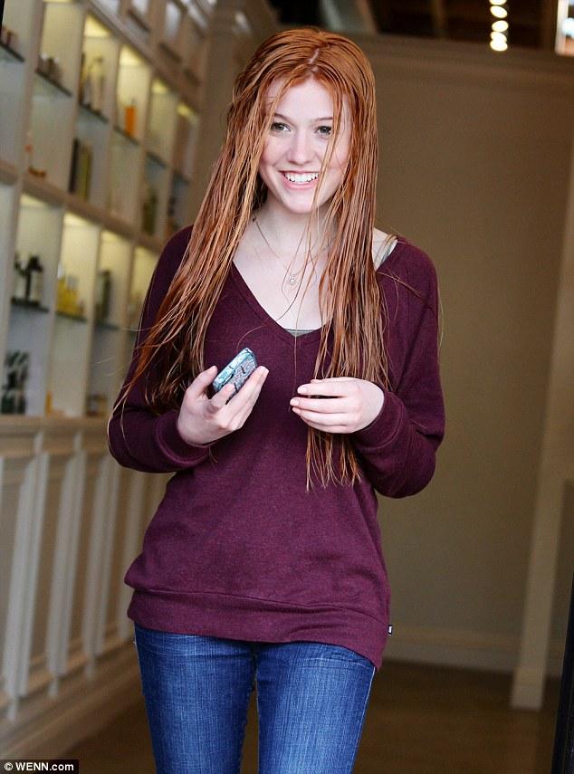 Scarlet: Katherine McNamara showed off her redder look as she left a salon in Los Angeles on Monday