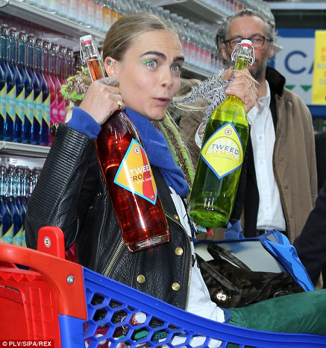 Fancy a drink? Cara had a giggle as she posed with two huge bottles