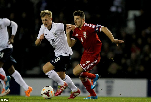 On the run: Wales' Lee Lucas holds off England's James Ward-Prowse
