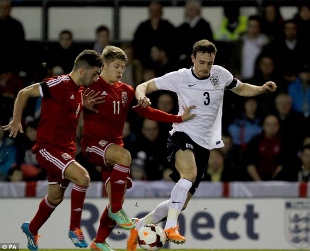 Tussle: England's Jack Robinson (right) holds off Wales Lloyd Isgrove and Lee Lucas (left)