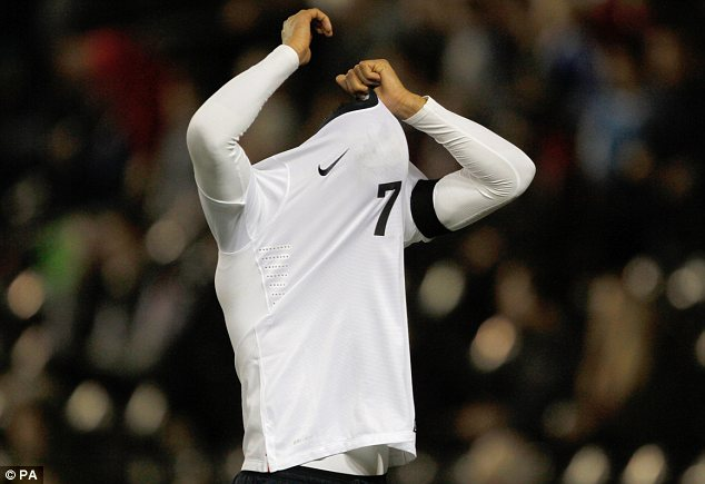 Tough going: England's Tom Ince covers his head after missing a chance
