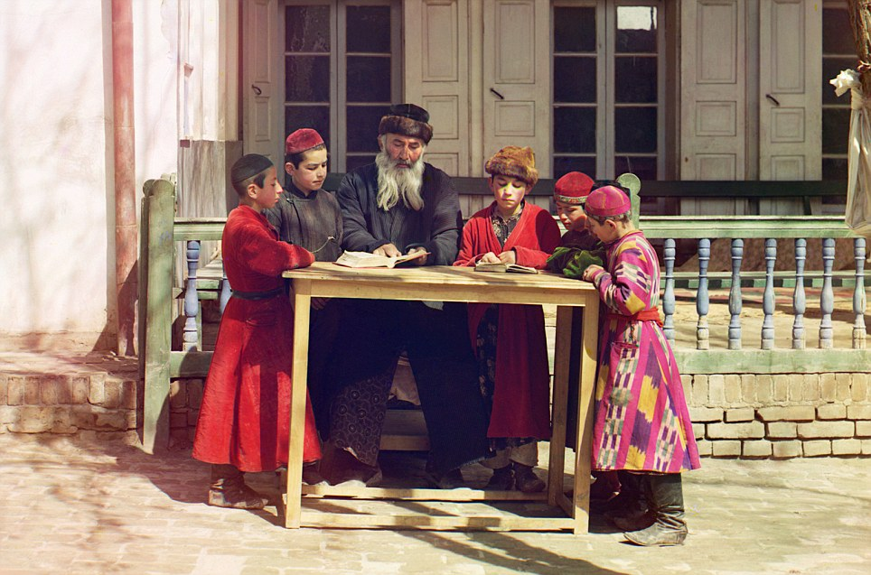 A group of Jewish children with their teacher: The vivid colours in the boys' coats are preserved for the historical record due to Sergey Prokudin-Gorsk's three-colour method