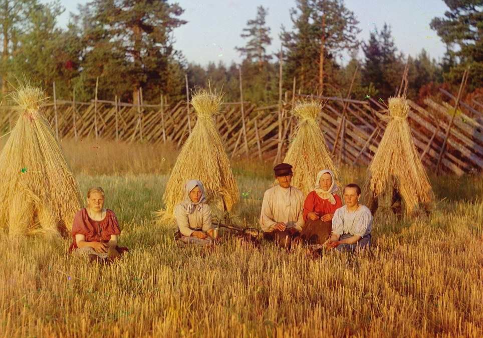 Two parents and their three daughters rest in a field as the sun sets, their agrarian way of life would be ruthlessly shut down in coming decades, as forced industrialisation occurred across the nation