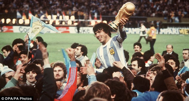 Star in stripes: Captain Daniel Passarella holds the World Cup in 1978 after Argentina's triumph on home soil