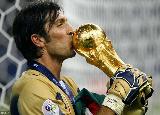 Glove story: Gianluigi Buffon kisses the trophy after Italy's shootout win in 2006