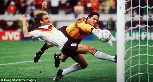 Strength of the Voller: Rudi Voller slides in to score for West Germany against Yugoslavia in 1990