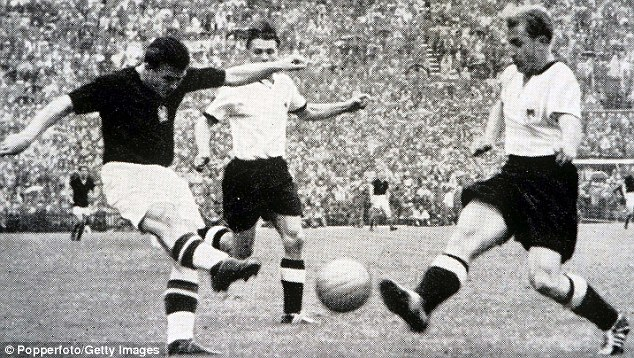 Magnificent Magyar: Ferenc Puskas (left) shoots for Hungary in the 1954 World Cup final - eight years later he represented Spain at the tournament in Chile