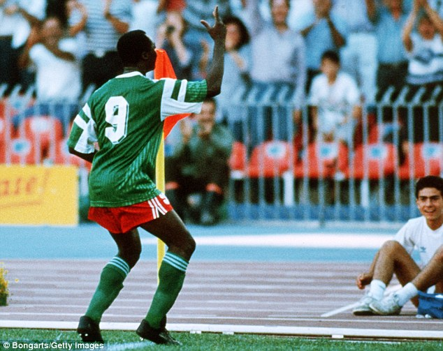 Dancing feet: Roger Milla performs his famous celebratory shuffle after scoring against Colombia in 1990