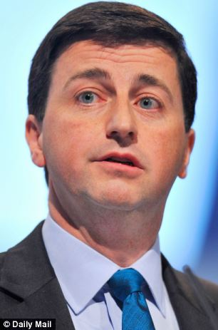 Ed Miliband sat next to his  foreign affairs spokesman, wee Douglas Alexander (pictured), yesterday