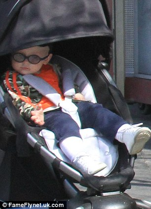 Strolling around: jack looked adorable in his little white shoes and glasses