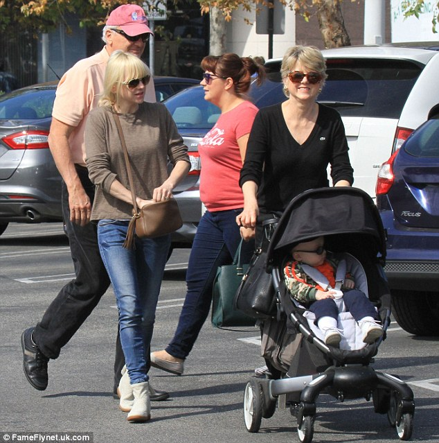 Doting grandmother: Anna's mother Karen took charge of the stroller with infant Jack inside