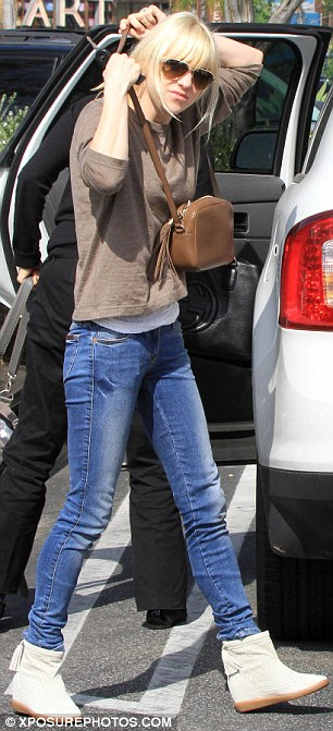 Mother of one: Anna dressed comfortably in blue jeans and a loose long-sleeved tee