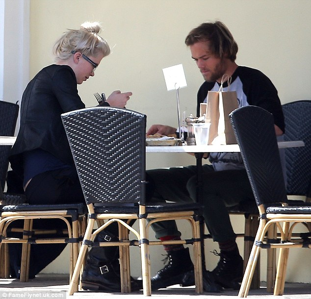 Tucking in: Ireland looked relaxed as she enjoyed some food with her boyfriend