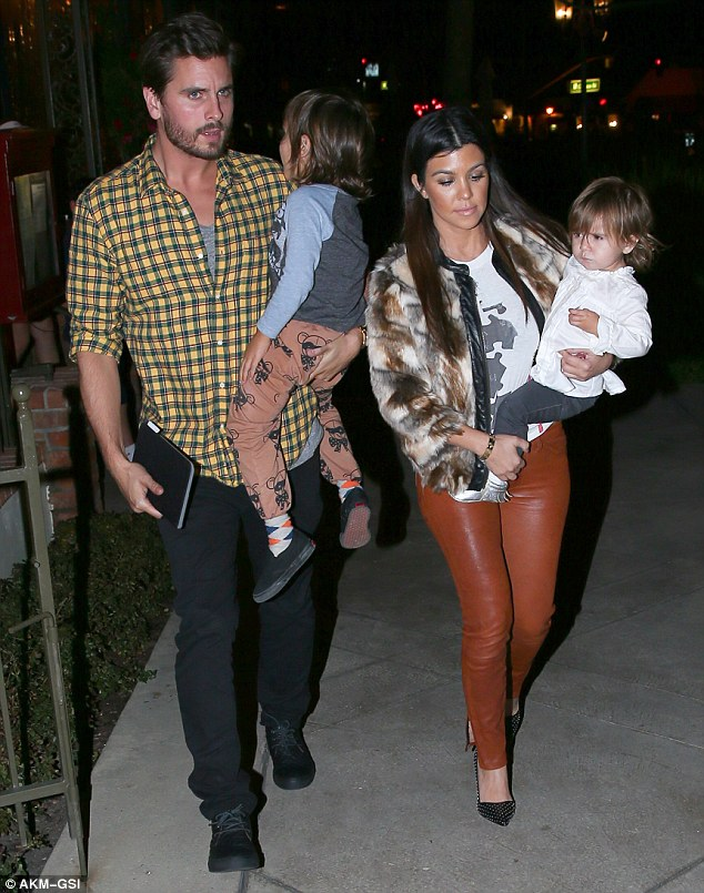 Connection: Police are linking the theft from Kourtney's home, pictured with her family on Tuesday, with another similar incident which saw $250,000 worth of jewellery stolen from her Khloe's Tarzana mansion, according to the website