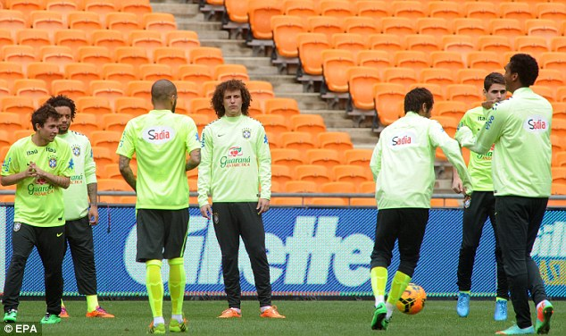 Down to business: Brazil go through some passing drills ahead of Wednesday's clash against South Africa