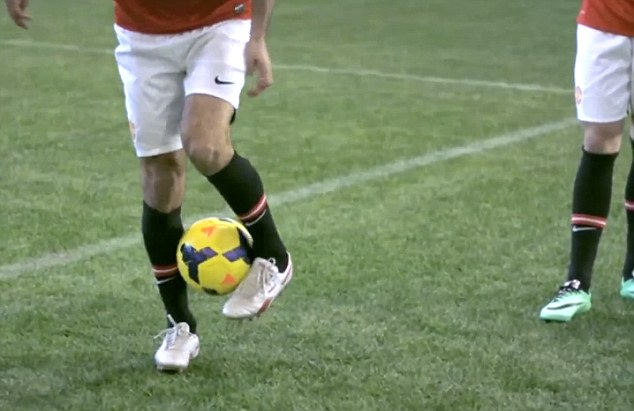 Control: Giggs (left) shows he hasn't lost his touch as he traps the football during United's DHL Trick Challenge