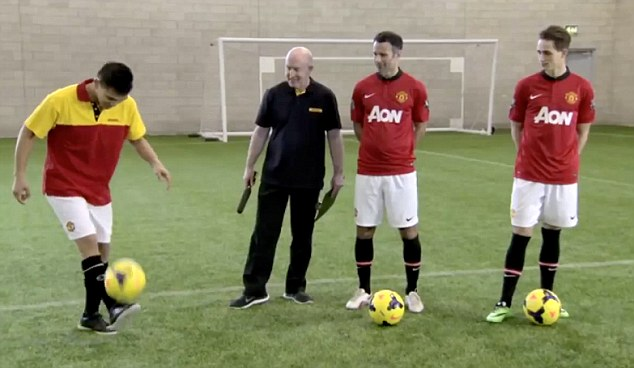 Watch and learn: Ryan Giggs (second right) and Adnan Januzaj (far right) watch the freestyler perform (far left)