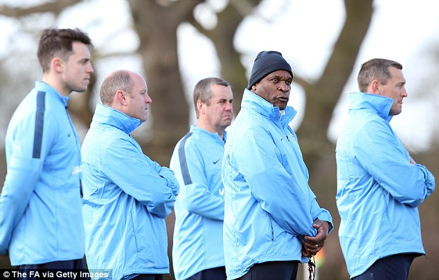 Close watch: Blake (second right) and Aidy Boothroyd (right) head up England's coaching team as the Under-19s train at the Carden Hotel and Spa in Chester