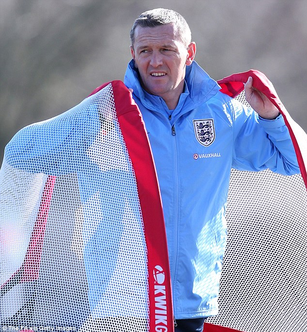 New appointment: New England Under-20 coach Aidy Boothroyd carries two portable goals during the session