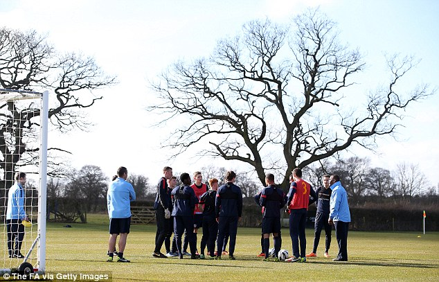 Team talk: The England players take on board instructions during their training camp before the match with Turkey