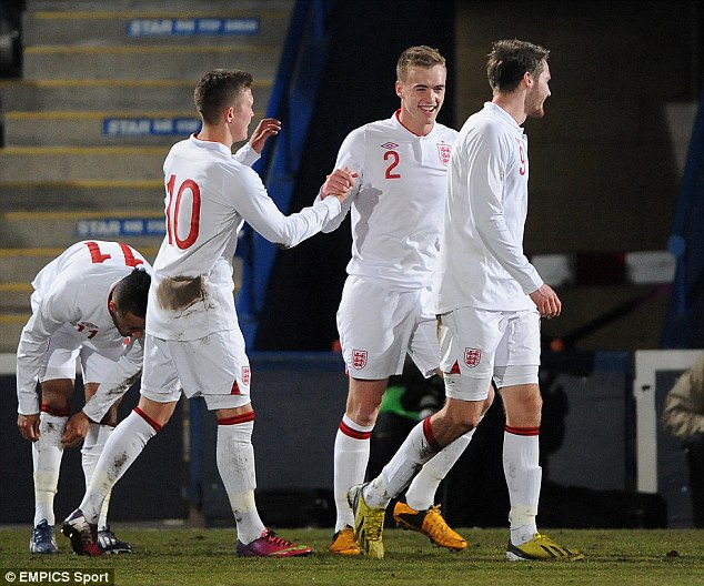 Match winner: Chambers (No 2) is congratulated by Max Clayton (No 10) after scoring the winner against Turkey in the last meeting of the sides last year