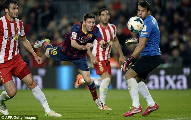 Another game another goal: Messi, seen here heading the ball past the Almeria keeper, scored again