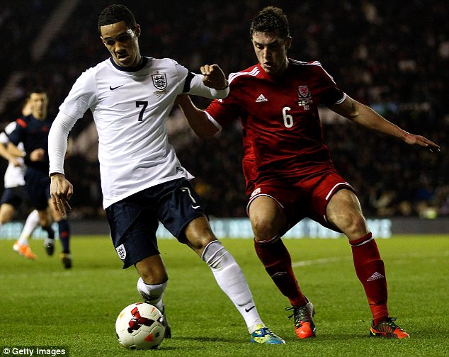 Impressive: Tom Ince of England holds off pressure from Joe Walsh of Wales