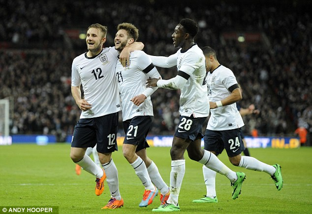 Creator: England players go to congratulate Lallana after the Southampton winger's great cross