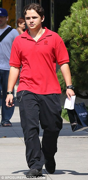 Fresh Prince: Jackson went for the preppy look in a red polo neck shirt and black trousers as he walked around Beverly Hills