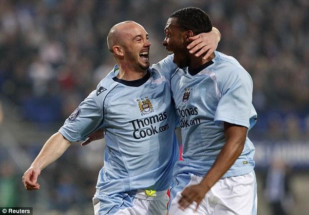 Early delight: Sturridge celebrates with midfielder Stephen Ireland during a match against Hamburg SV