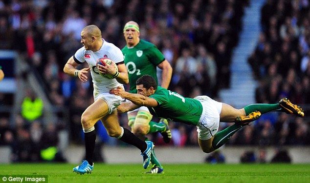 Not close enough: Ireland's Rob Kearney fails to stop Mike Brown as England secured a narrow 13-10 win