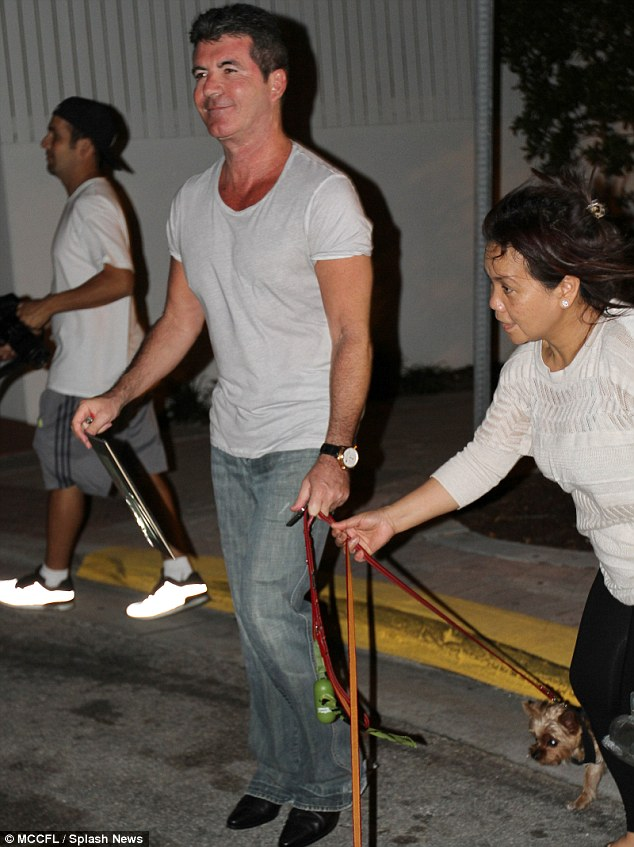 He doesn't travel light! Simon and Lauren were seen leaving their Miami Beach hotel on Wednesday armed with masses of luggage