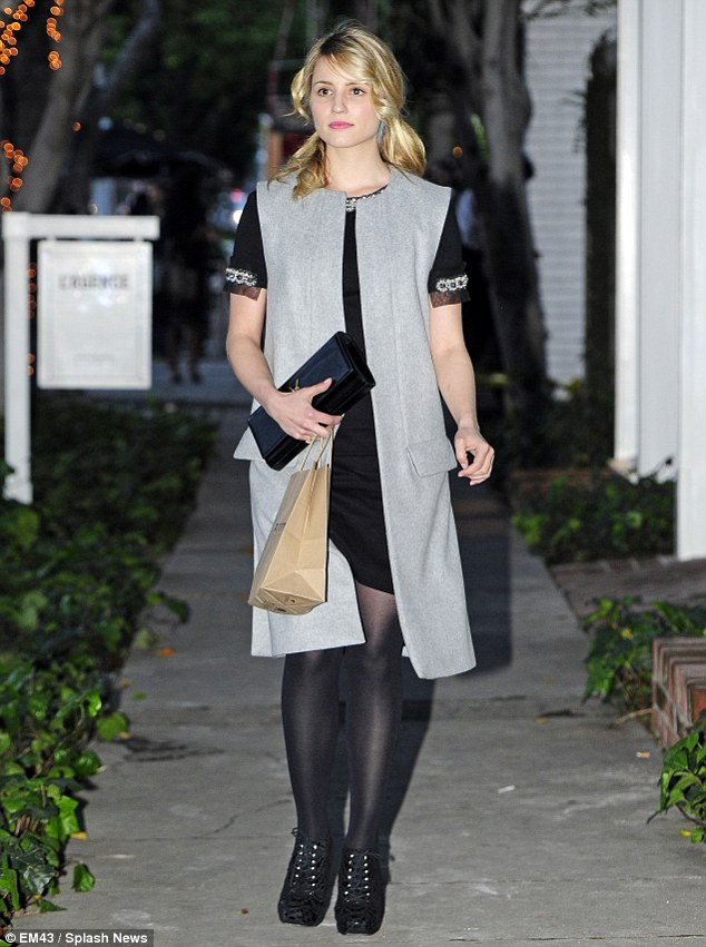 Elegant: The former Glee star wore a black frock that featured bejewelled chiffon sleeves under a sleeveless grey jacket