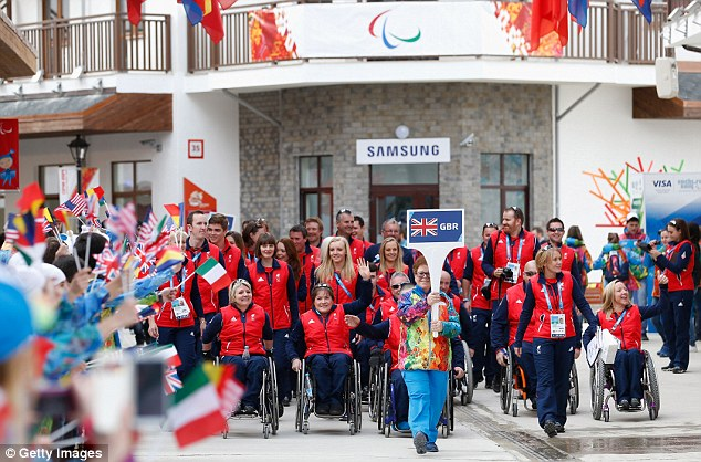 Welcome: British athletes make their way to the welcome ceremony in the Athletes Village, Sochi