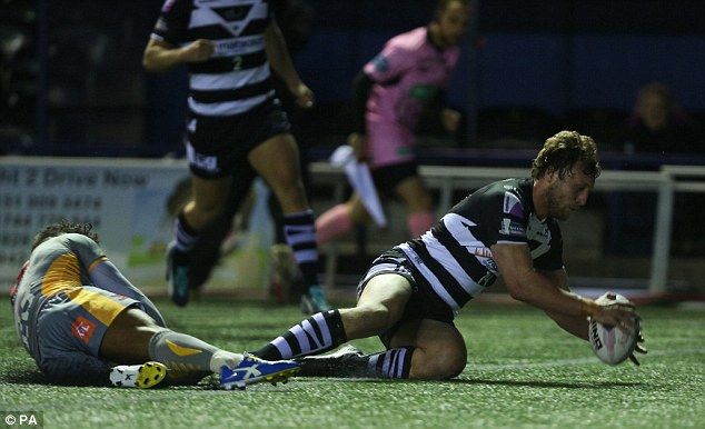 Crossing the line: Chris Dean scores a try for second placed Widnes