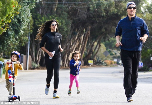 Healthy family: Matthew, wife Camila and children Levi and Vida worked out together last month in Malibu, California