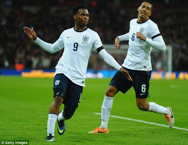 Lethal: Sturridge celebrates after a fine header from Adam Lallana's inviting cross handed England the win