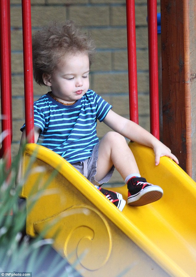 Playing around: Hudson, who turned two on Monday, was clearly having a ball at the playground