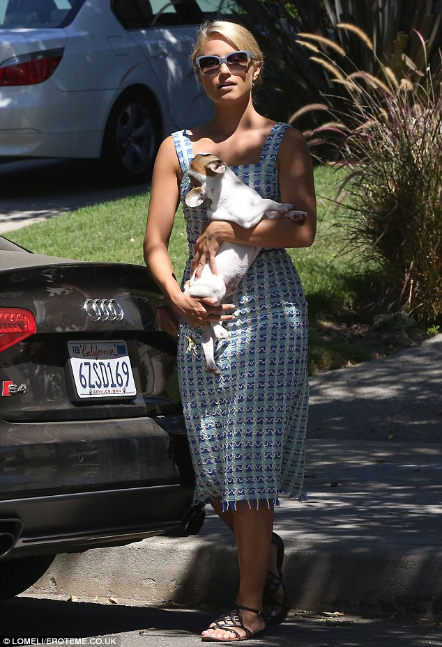 Her main man: Dianna dotes over her French Bulldog Freddie, pictured together in September in LA