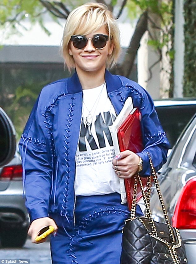 Casual chic: The singing sensation opted for a casual look with her tousled blonde hair and appeared to be in good spirits